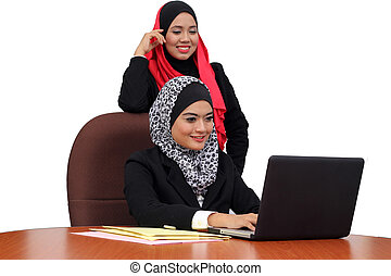 Young beutifull muslim women happy in business wear working...