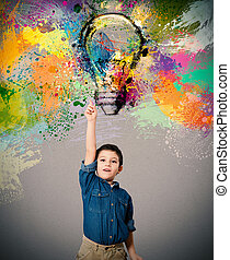 Young big idea - Child indicates a big colored bulb designed