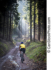 Young biker on muddy road - Sowie mountains, Poland