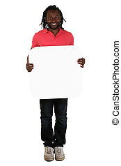 Young black African man holding copyspace for letter or text
