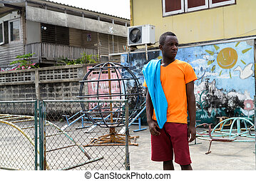 Young black African man thinking with jacket over his shoulder w