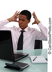 young black businessman looking exasperated