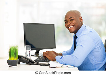 young black businessman using computer