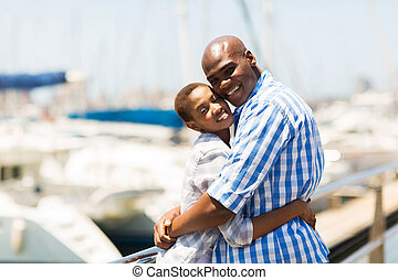 young black couple at the harbor