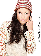 young black hair woman in wool sweater and cap