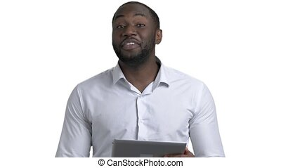 Young black man lecture speech. Portrait of african man holding tablet and talking against white isolated background.