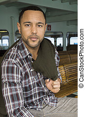 Young Black Man of Ferry Boat - Young black man with sweater...