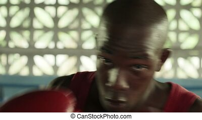 Young black man training as boxer