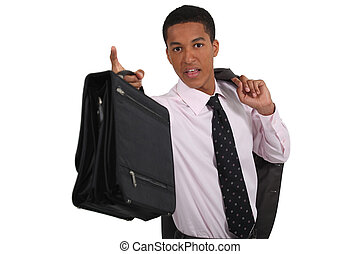 young black manager with coat over shoulder holding ...