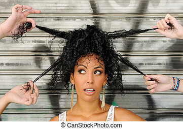 Young black woman, afro hairstyle, in urban background - ...