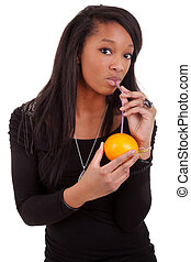 young black woman drinking orange juice