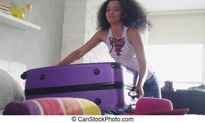 Young Black Woman Falling To Ground For Heavy Travel Bag -...