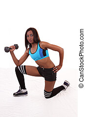 Young Black woman holding weight kneeling exercising