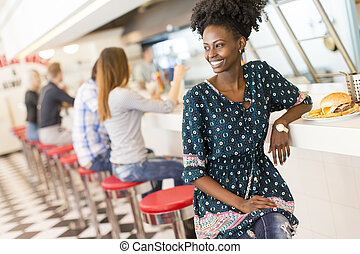 Young black woman in the diner