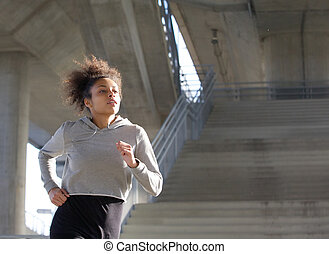 Young black woman jogging outdoors
