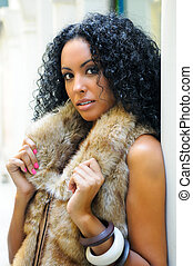 Young black woman, model of fashion, wearing fur vest -...