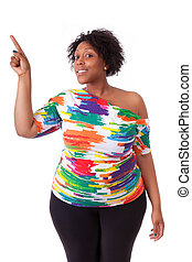 Young black woman pointing up - African people