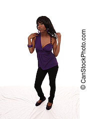 Young black woman purple top jeans standing
