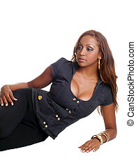 Young black woman reclining on floor cleavage