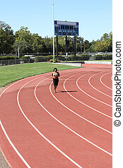 Young black woman running on track long shot
