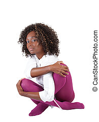 Young black woman sitting in purple tights