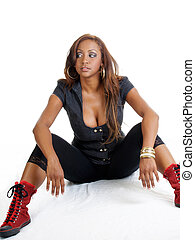 Young black woman sitting with red shoes