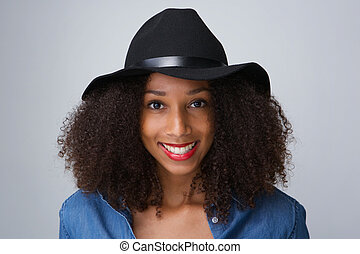 Young black woman smiling with hat