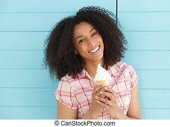 Young black woman smiling with ice cream