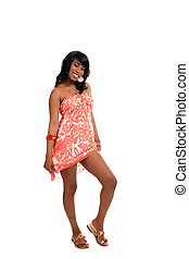 Young black woman standing in dress smiling
