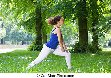 Young black woman stretching