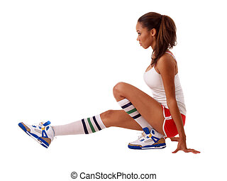 Young black woman stretching out in shorts