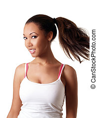 Young black woman swinging pony tail smiling
