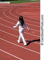 Young black woman walking sweat suit on track