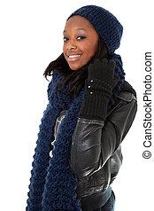 Young black woman wearing winter dress