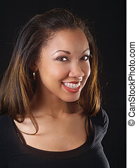 Young black woman with big smile and braces