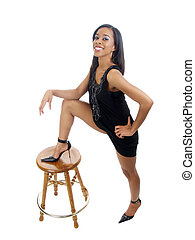 Young black woman with foot on top of stool