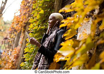 Young black woman with mobile phone