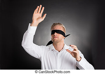 Young Blindfolded Businessman