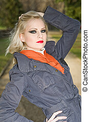 Young blond fashion model outdoors.