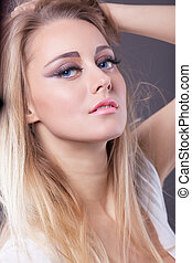Young blond girl close-up portrait look at you