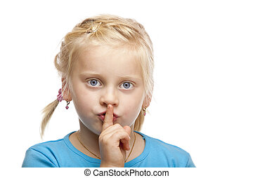 Young blond girl holds finger on mouth