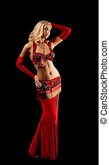 Young blond girl in dance - red arabian costume