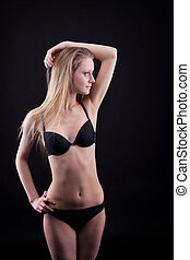 Young blond girl in lingerie - look at light