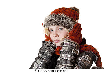 Young blond girl in winter clothes warms her ears