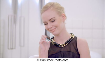 Young Blond Girl Talking Cell Phone