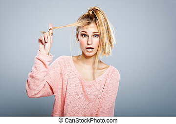 Young Blond Girl with Hair Problems