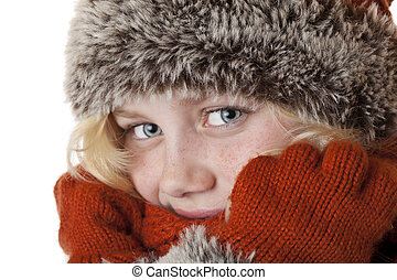 Young blond girl with winter cap and gloves