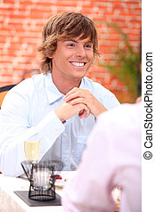 Young blond in restaurant