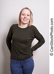young blond millennial woman smiling