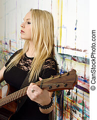 Young blond playing guitar
